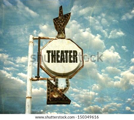 aged and worn photo of vintage theater sign with arrow                               - stock photo