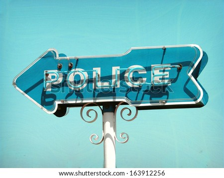 aged and worn retro photo of neon police sign                              - stock photo