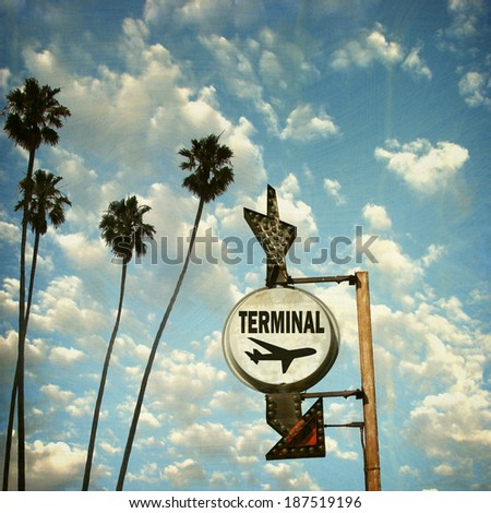 aged and worn vintage photo of  airport terminal sign with palm trees                             - stock photo