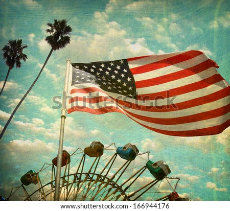 aged and worn vintage photo of american flag with ferris wheel and palm trees                             - stock photo