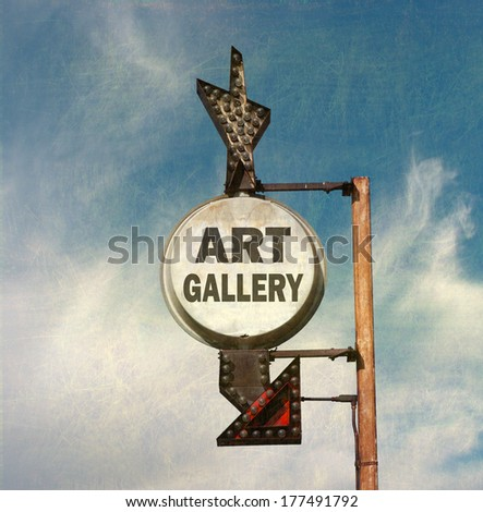 aged and worn vintage photo of art gallery sign                             - stock photo