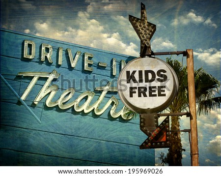 aged and worn vintage photo of  drive in theater kids free sign                            - stock photo