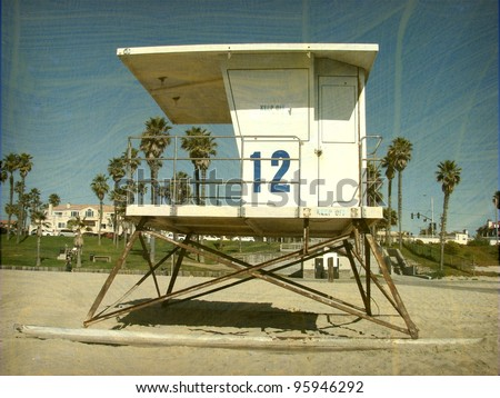 aged and worn vintage photo of  lifeguard stand on beach - stock photo