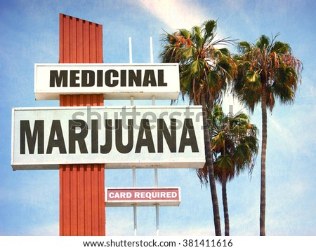 aged and worn vintage photo of medicinal marijuana sign with palm trees - stock photo
