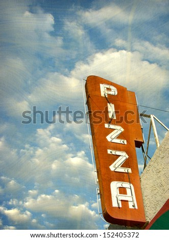 aged and worn vintage photo of neon pizza sign                               - stock photo