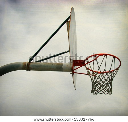 aged and worn vintage photo of  outdoors basketball hoop - stock photo