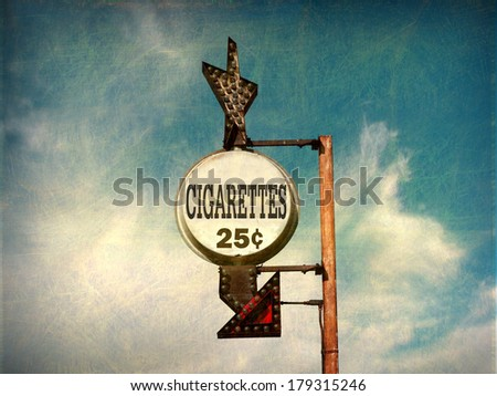 aged and worn vintage photo of retro cheap cigarettes sign                               - stock photo