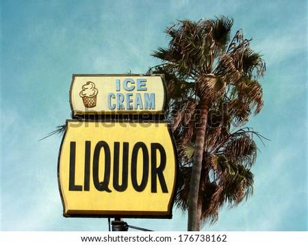 aged and worn vintage photo of retro ice cream and liquor sign                              - stock photo
