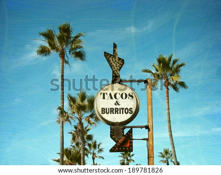 aged and worn vintage photo of tacos and burritos sign with palm trees                              - stock photo