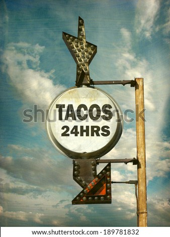 aged and worn vintage photo of tacos sign                               - stock photo