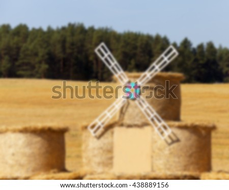 Agricultural field on which were left lying Straw Haystacks after the wheat harvest, grain field, farming and organic foods, autumn season, defocus - stock photo