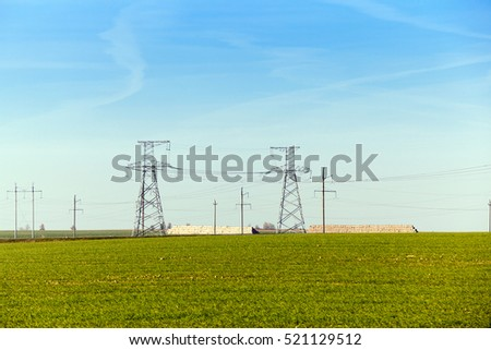 Agricultural field on which were left lying Straw Haystacks after the wheat harvest, grain field, farming and organic foods, autumn season, blue sky
