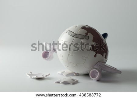 airplane puzzle with some incomplete pieces for airplane crashing concept - stock photo