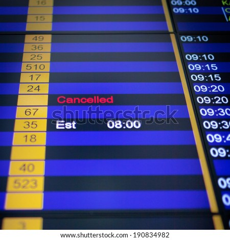 Airport arrival board in airport terminal. Flight cancelled. - stock photo