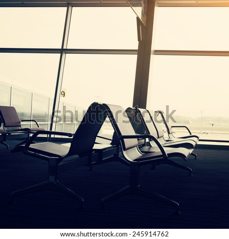 Airport hall interior with chairs, toned yellow - stock photo
