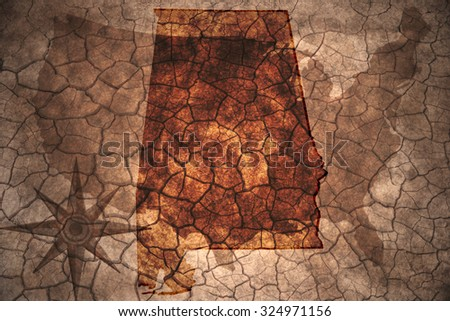 Alabama state map on vintage usa map, crack paper background - stock photo