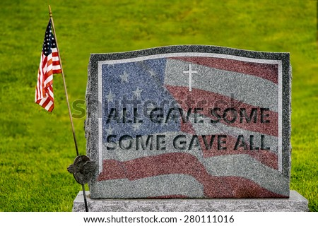 """""""All Gave Some, Some Gave All"""" etched into a gravestone with the American flag  - stock photo"""
