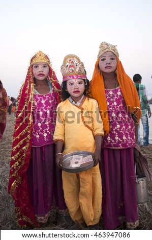 ALLAHABAD, INDIA - MARCH 07, 2013 : unidentified indian girl dresses like Goddess for tourist take photo near confluence of the Ganges and Yamuna River during the festival Kumbh Mela.