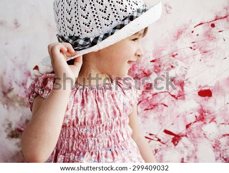 amazing little girl in hat,on the art background - stock photo