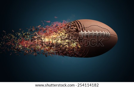 American football ball in fire flying - stock photo