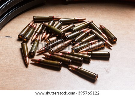 7.62 ammo for machine guns with loaded magazines on table - stock photo