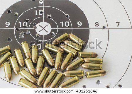ammunition and gun target - stock photo