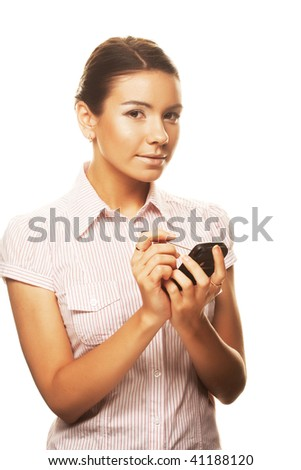 An attractive young woman makes notes on her PDA - stock photo