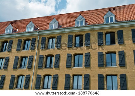 An old building near the port and the canals turned into  hotel Copenhagen Denmark                               - stock photo