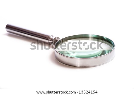 An old, vintage magnifying glass on a white background