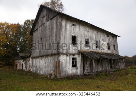 an old wooden abandoned mill white color. Belarus - stock photo