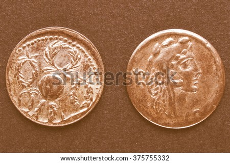 Ancient Roman coins on a black background vintage