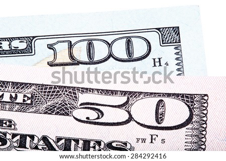 100 and 50 dollars (banknote) bills isolated on white background. Stacked macro photo. - stock photo