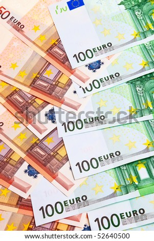 100 and 50 Euro banknotes in random pattern on each other.