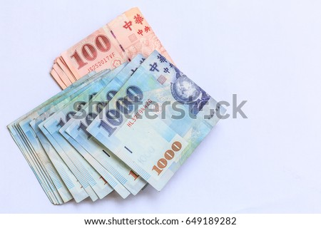 100 and 1000 Taiwan dollar bank note. New Taiwan dollar is the national currency of Taiwan, Taiwan new dollar bill on white background, (TWD)
