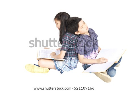 10 and 7 years Asian school girl and boy sitting sleeping reading book together isolated over white