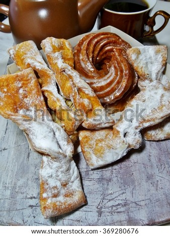 Angel wings (Faworki), cakes deep fried in oil to celebrate Fat Tuesday and cookies and donut Vienna - stock photo