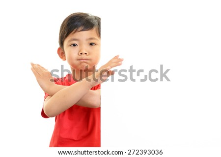 Angry little Asian boy - stock photo