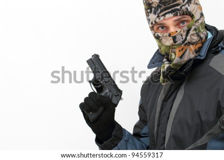 angry looking masked man with a handgun