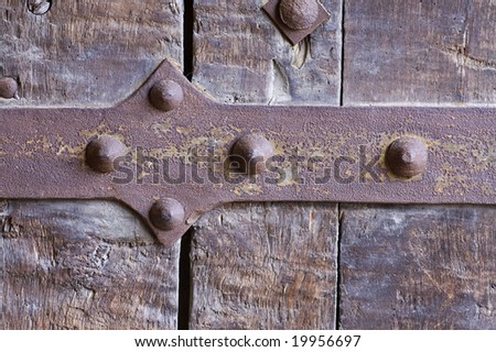 antique forged door background - stock photo