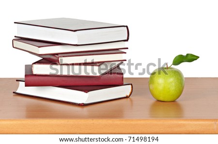 apple and books on desk - stock photo