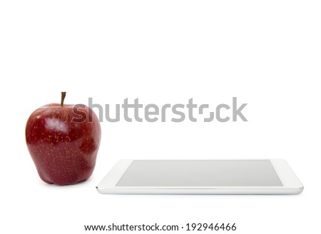 apple on digital tablet pc on white background