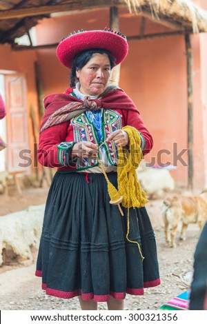 29 APR 2015  : Local Peruvian weaves multi-colored fabrics, Sacred Valley, Peru