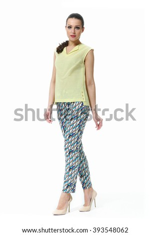 arabian asian eastern brunette business executive woman with straight hair style in printed ethnic summer trousers and t-shirt high heel shoes standing full body length isolated on white - stock photo