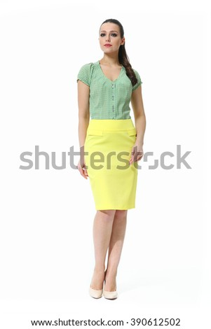 arabian asian eastern brunette business executive woman with straight hair style in printed summer blouse and yellow skirt high heel shoes standing full body length isolated on white - stock photo