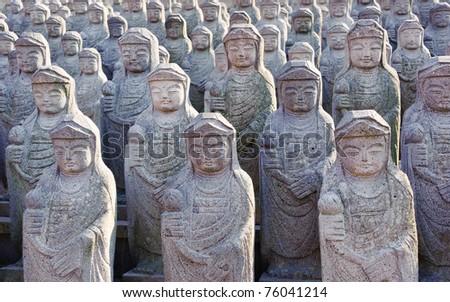 1000 arahan statues at  Gwaneumsa buddhist Temple at Jeju Island Korea - stock photo
