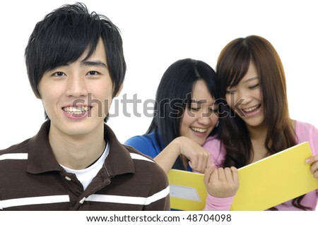 3asian happy university students over a white background-focus on young smile man - stock photo