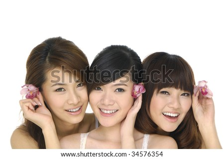 3 asian model holding pink orchid