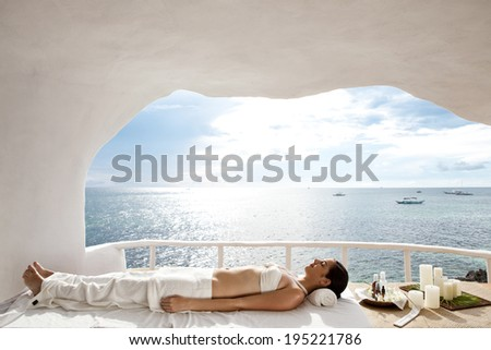 Asian woman having a massage treatment in Boracay in the Philippines