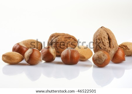 Assortment of nuts displayed on white background