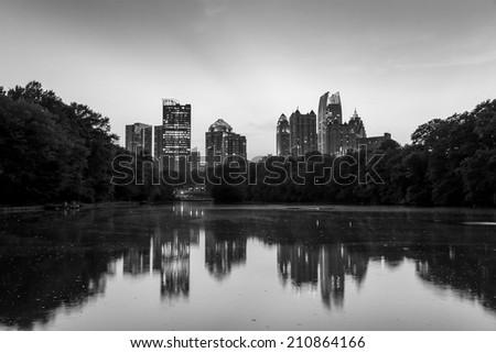 Atlanta, Georgia Skyline from Piedmont Park's Lake Meer, black, white - stock photo